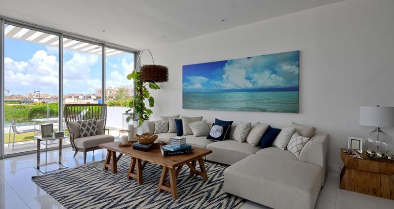 salon comedor con vistas al jardin ocean21 villas marina cap cana